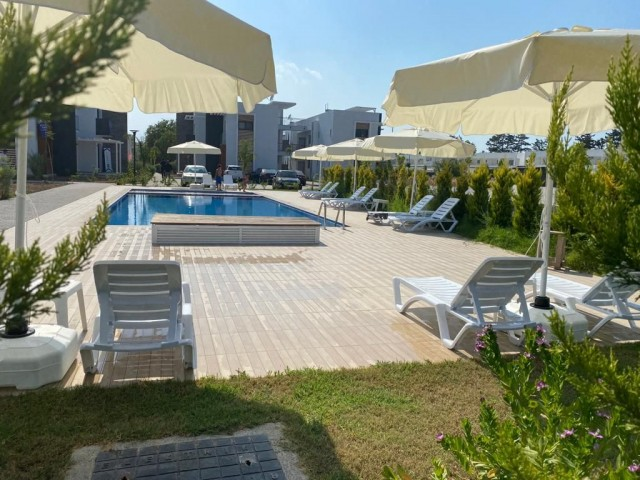 Newly Constructed 'UNFURNISHED' 2 + 1 Apartment with large roof terrace and shared pool in the heart of Ozankoy