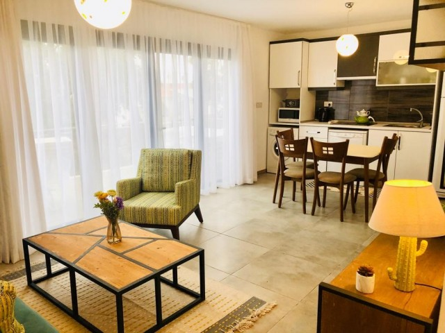 1+1 Luxury apartment with garden for rent in Alsancak, in a complex with pool